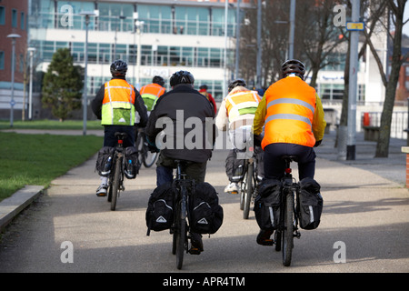 group of cyclists wearing hi vis jackets on cycle path in laganside Belfast Northern Ireland UK - Stock Photo