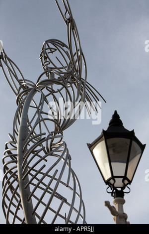 thanksgiving beacon sculpture beacon of hope by artist Andy Scott and old style streetlight in thanksgiving square - Stock Photo