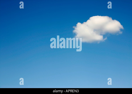 A single cloud in a blue sky. - Stock Photo