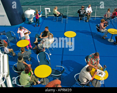 passangers on sundeck of the ferry of Scanlines on see from Puttgarden in Germany to Rodby in Denmark - Stock Photo