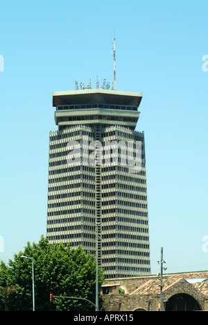 Barcelona modern high rise building with communication equipment aerials on roof - Stock Photo