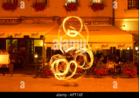 Poland Dolnoslaskie Wroclaw Fire eating Street Performer in front of Restaurant Rynek Main Market Square  Old Town - Stock Photo