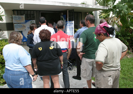 Miami Beach Florida Precinct 46 Election Day voters line polling place - Stock Photo