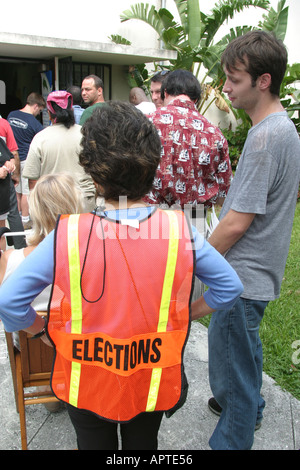 Miami Beach Florida Precinct 46 Election Day voters line polling place elections observer - Stock Photo