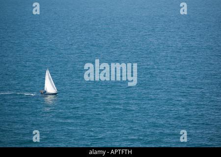 Yacht sailing on sea - Stock Photo