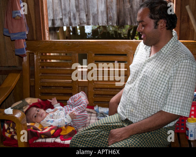 Burmese father and his newborn babe Inle Lake Myanmar - Stock Photo