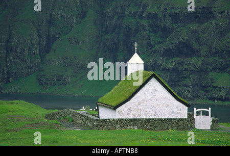 Alone Standing Church in a Dramatic Fjord at Saksun on the Faroe Islands - Stock Photo