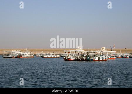 Felucca in Front of Aswan Dam [Aswan, Egypt, Arab States, Africa].                                              - Stock Photo