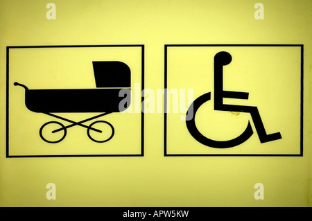 signs at a toilet baby carriage and wheel chair symbols for handicapped accessible toilet and washroom for baby - Stock Photo