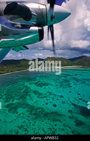 View from aircraft window Leaving Praslin Island Seychelles - Stock Photo