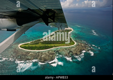 View from aircraft window Leaving Bird Island Seychelles - Stock Photo