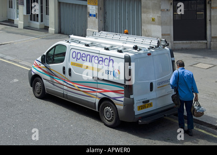 British Telecom BT Openreach service engineer carrying his tool bag from Vauxhall Vivaro van - Stock Photo