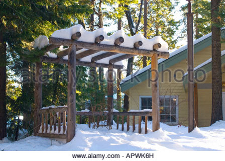 gazebo with rusty chair covered in snow - Stock Photo