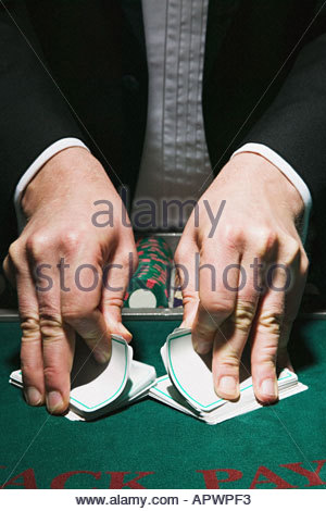 Dealer shuffling cards - Stock Photo