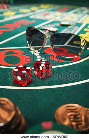 Sunglasses on a craps table - Stock Photo