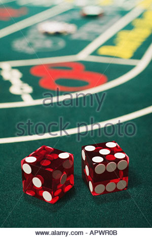 Dice on a craps table - Stock Photo