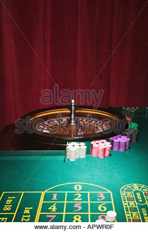 Roulette wheel and table - Stock Photo