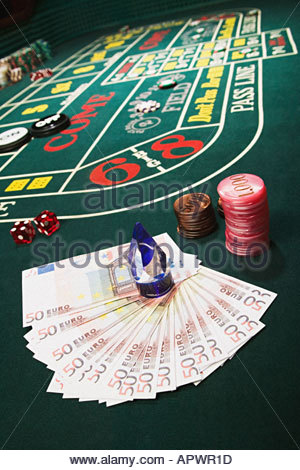 Money and chips on a craps table - Stock Photo