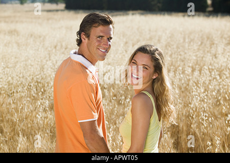 Couple in a field of wheat - Stock Photo