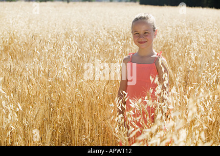 Girl in a field of wheat - Stock Photo
