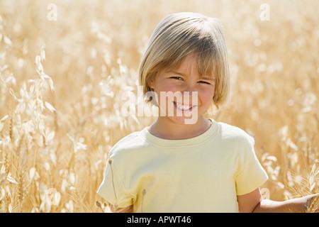 Boy in a wheat field - Stock Photo