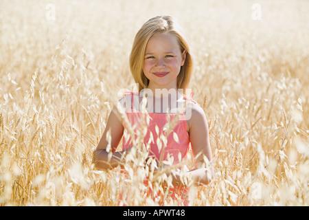 Girl in a cornfield - Stock Photo