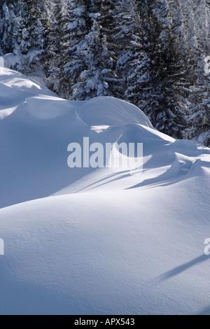 Drifting snow on mountain ridge. - Stock Photo