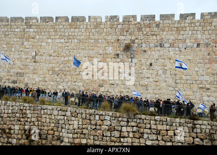 Jewish protesters form human chain around the walls of the old city  in Jerusalem Israel protesting US president - Stock Photo