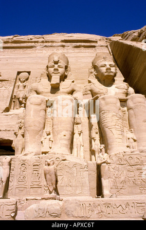 Abu Simbel facade of the main temple with colossal statues of Rameses II - Stock Photo