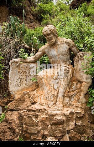 Sculpture of Moses with the 10 commandments near the Echo caves by artist Piet van Zyl - Stock Photo