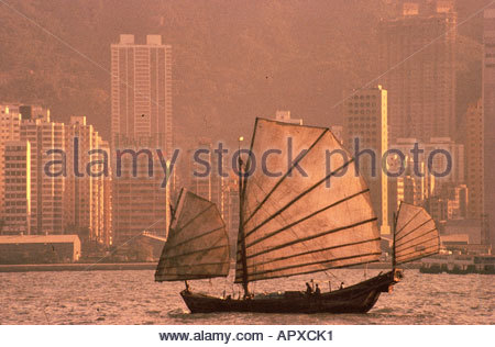 Junk in front of Skyline, Hongkong China - Stock Photo