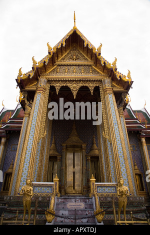 Main entrance doors to Wat Phra Kaew temple in the Grand Palace complex, Bangkok, Thailand - Stock Photo