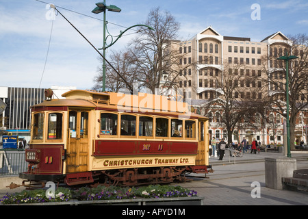 City Loop red tram in Cathedral Square giving sightseeing tours to tourists on tramway circuit Christchurch New - Stock Photo