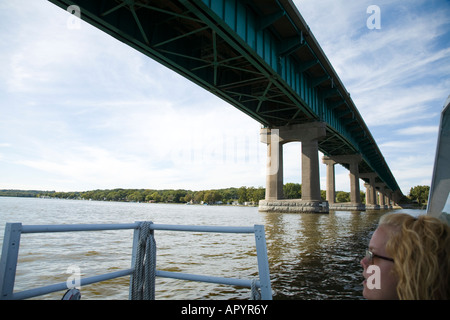 IOWA LeClaire River tour boat passing under two bridges over Mississippi River between Iowa and Illinois view from - Stock Photo