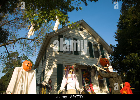 illinois dixon ghoulish halloween decorations in front yard of house pumpkin head executioner scary people standing - Front Yard Halloween Decorations