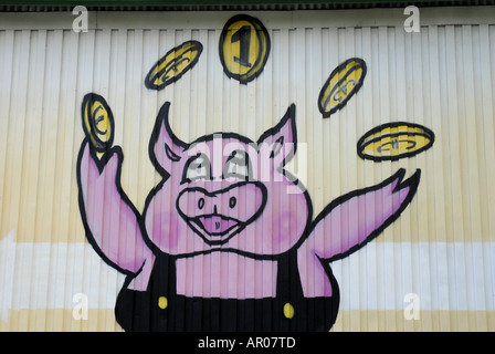 Advertisement on a house wall - Stock Photo