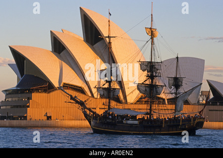 Sydney Opera House and sailing ship in the evening, Sydney Opera House, Sydney, Sydney Harbour, New South Wales, - Stock Photo