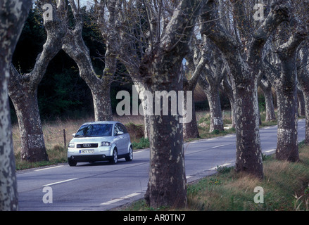 Car driving along road in south of France - Stock Photo