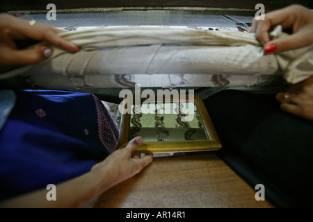 Handwoven, embroidery on loom, Weberei, Handarbeit, Webstuhl, Spiegel zeigt Muster Mirror under the loom shows embroidery - Stock Photo