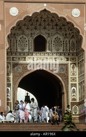 Entrer to theBadshahi Mosque in Lahore is a picture in stone. Students going in and out, the mosque was built by - Stock Photo