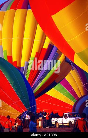 Crews prepare hot air balloons for flight at Balloon festival Albuquerque NM