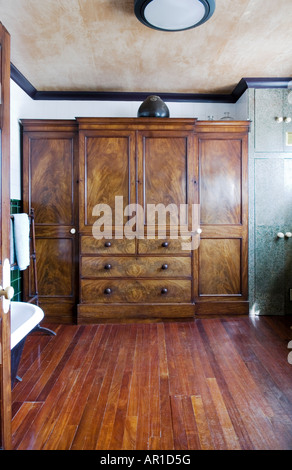 19th century walnut cabinet in gentleman's bathroom - Stock Photo