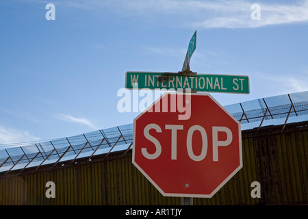Nogales Arizona A section of the border fence along International Street separating the United States from Mexico - Stock Photo