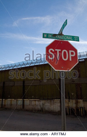 Border Fence Between United States and Mexico - Stock Photo