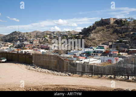 Nogales Arizona A section of the border fence that separates the United States in the foreground from Mexico - Stock Photo