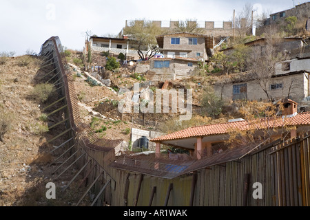 Nogales Arizona A section of the border fence that separates the United States on the left from Mexico - Stock Photo