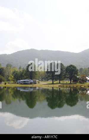 Trees and mountains reflect in lake on private campground in northern Georgia, USA, - Stock Photo