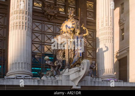 Horizontal close up of Gilbert Bayes ornamental 'Queen of Time' statue and clock above the entrance to Selfridges - Stock Photo