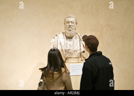 Young Couple Admiring a Marble Bust of Francesco Bocchetta at the Metropolitan Museum of Art in New York City - Stock Photo