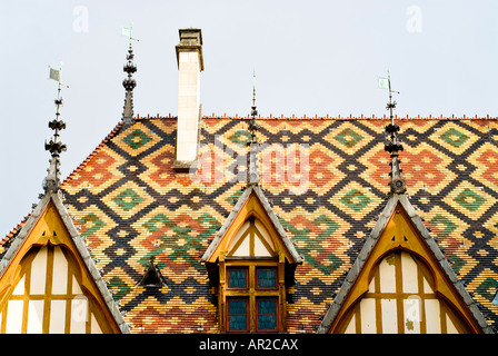 The colorful tiled roof of the Hotel Dieu / Hospices de Beune in Beaune in the heart of France's Burgundy (Bourgogne) - Stock Photo